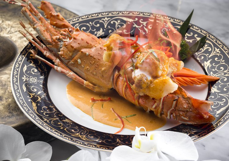 Signature dish: Mung korn lui fai (Flambéed Phuket lobster served with sweet red curry sauce)